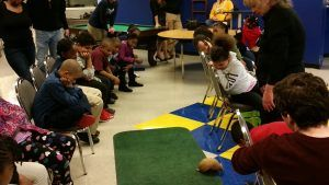 The students watch captivated by the wild armadillo.