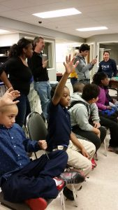 Students raising their hands to ask a question